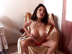 Asian babe toys her pussy