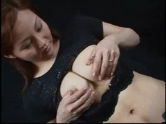 Asian babe with lactating tits squeezes and squirts